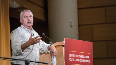 Tom Friedman speaks at a podium with the CSPG logo