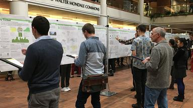 Poster session in the atrium of the Humphrey School