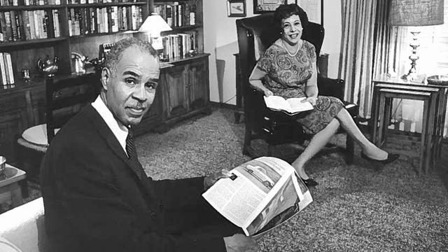 Roy Wilkins and his wife Aminda sitting in the library at their home.
