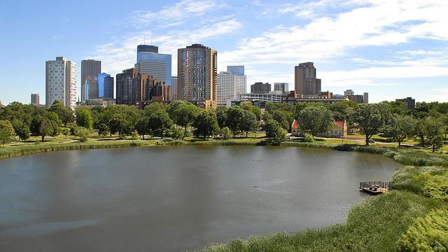 A small lake with Minneapolis high-rise buildings in the background