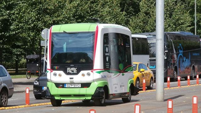 A driverless bus on a busy street